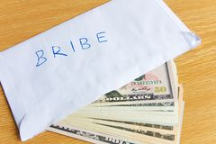 Bribe. In an envelope with dollars stock photos