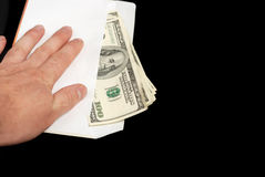 Bribe in an envelope and hand stock images