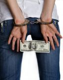 For a bribe - in handcuffs. The fight against corruption. Woman arrested for bribery Stock Image