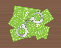 Bribe and handcuffs Royalty Free Stock Photography