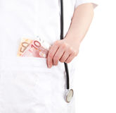 Bribe in medicine Stock Photos