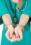 Bribe in medicine Stock Images