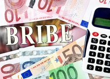 Bribe word with money Stock Photo