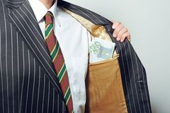 Bribed businessman Royalty Free Stock Photo