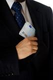 Briber. Corruption concept, man putting money into his pocket Stock Image
