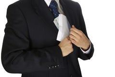 Briber. Corruption concept, man putting money into his pocket Royalty Free Stock Image