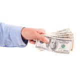 Bribery cash in hand of man isolated. On white Royalty Free Stock Photo