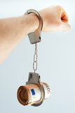 Bribery concept. Hand with handcuffs and money. Bribery concept Royalty Free Stock Images