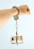 Bribery concept. Hand with handcuffs and money. Bribery concept Royalty Free Stock Photography