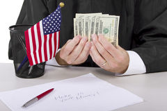 Bribery. Corrupt american judge taking money as a bribe or stealing royalty free stock photos