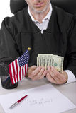 Bribery. Corrupt american judge taking money as a bribe or stealing Stock Images