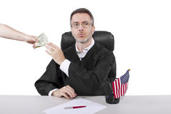 Bribery. Corrupt american judge taking money as a bribe or stealing Stock Image