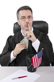 Bribery. Corrupt american judge taking money as a bribe or stealing Royalty Free Stock Images