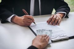 Bribery and corruption concept, bribe in the form of dollar bill. S, Businessman giving money while making deal to agreement a real estate contract and financial Stock Photos
