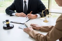 Bribery and corruption concept, bribe in the form of dollar bill. S, Businesswoman giving money to male lawyer while helps making deal to agreement a real estate Stock Photos