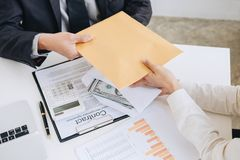Bribery and corruption concept, bribe in the form of dollar bill. S, Businessman giving money while making deal to agreement a real estate contract and financial Stock Photo