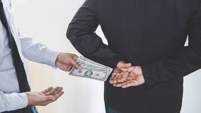 Bribery and corruption concept, bribe in the form of dollar bills, Businessman giving money while making deal to agreement royalty free stock photos
