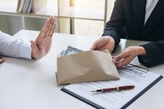 Bribery and corruption concept, Businessman refusing receive mon. Ey in the envelope to agreement contract, A bribe in the form of dollar bills Royalty Free Stock Photography