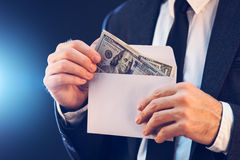 Bribery and corruption concept with cash money in envelope Royalty Free Stock Photo