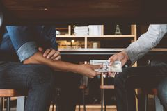 Bribery, Hands passing money under table, Corruption and bribery royalty free stock photography