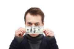 Bribery - young man paid to hold his silence Royalty Free Stock Images