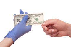 Bribes in medicine Royalty Free Stock Image