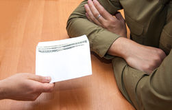 Bribes in a white envelope. On the table in the office Royalty Free Stock Images