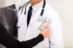 Bribing doctor Royalty Free Stock Images