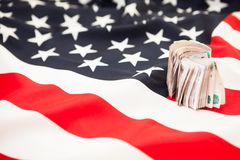 Bribing Russian money lying on the US flag background Royalty Free Stock Photo