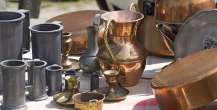 Bric-a-brac of copper and tin objects at flea market Stock Photos