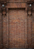 Brick alcove, niche with half-columns on each side and two lante Stock Photography