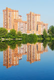 Brick apartment houses along city pond Stock Photo