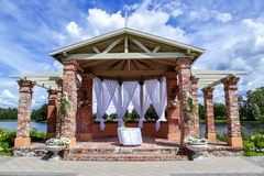 Brick arbour with white light curtains Royalty Free Stock Photography