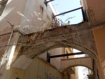 Brick Arch between Building in Gaeta in Lazio region in Italy. Gaeta, Italy - October 12, 2017: Brick Arch between buildings in Passage in Gaeta in Lazio region Stock Photography