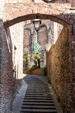 Brick arch with staircase and black and green flag in the center stock images