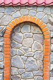 Brick arch in the stone wall. Roof visor Royalty Free Stock Images