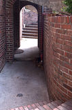 Brick Archway With Steps. Brick arch way with steps going up and down Royalty Free Stock Images