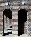 Brick Arches. Many red brick arches in a row with dark shadows in between Stock Images