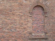 Brick archway. Arched window in brick wall that has been bricked up stock image