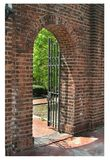 Brick archway in historic Philadelphia. This old brick archway door, with its fine wrought-iron gate, stands near the University of Pennsylvania campus in Royalty Free Stock Photo