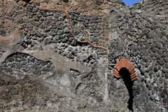 Brick Archway and Stone Wall, Pompeii Archaeological Site, nr Mount Vesuvius, Italy Stock Image