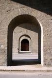 Brick archways. Archways through thick brick or masonry walls.  Sunlight and shadows Stock Image