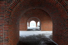 Brick archways with a view of the sea Royalty Free Stock Images