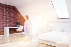 Brick attic bedroom, wood floor, home office, girl Royalty Free Stock Images