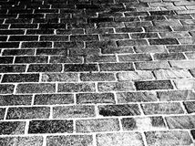 Brick Background. A background black and white photograph of bricks, going from very dark in the top left corner to lighter in the bottom right Royalty Free Stock Image