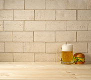 Brick background, beer and burger Royalty Free Stock Images