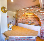 Brick backsplash and arch with stove in ranch style home in Fallbrook California in San Diego county. Model home kitchen in southern California ready for a real stock photo