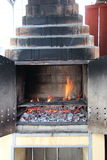 Brick barbecue with flames ready to be used Royalty Free Stock Image