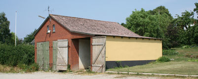 Brick barn in countryside. Exterior of brick barn building in countryside Royalty Free Stock Photography