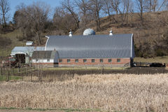 An Brick Barn with a Metal Roof Stock Photography